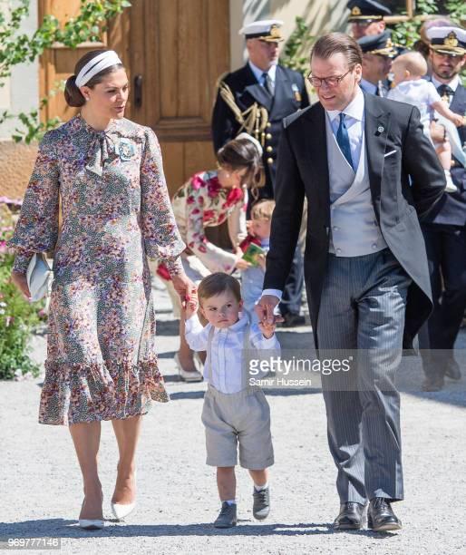 Crown Princess Victoria of Sweden Prince Oscar of Sweden and Prince Daniel of Sweden attend the christening of Princess Adrienne of Sweden at...