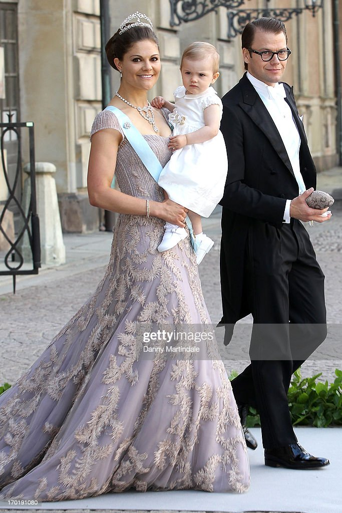 Crown Princess Victoria of Sweden, Princess Estelle of Sweden and Prince Daniel of Sweden attend the wedding of Princess Madeleine of Sweden and Christopher O'Neill hosted by King Carl Gustaf XIV and Queen Silvia at The Royal Palace on June 8, 2013 in Stockholm, Sweden.