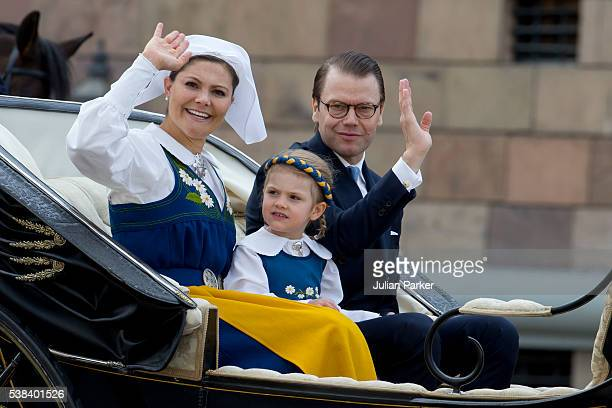 Crown Princess Victoria of Sweden Princess Estelle of Sweden and Prince Daniel of Sweden during a carriage procession on Sweden's National Day...