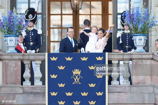 Crown Princess Victoria of Sweden, Princess Estelle of Sweden and Prince Daniel of Sweden wave to fans waiting outside the Royal Palace for Princess...