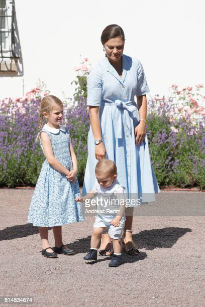 Crown Princess Victoria of Sweden Princess Estelle of Sweden and Prince Oscar of Sweden are seen meeting the people gathered in front of Solliden...