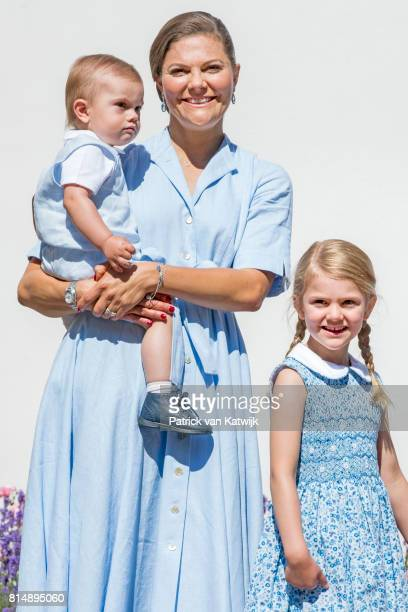 Crown Princess Victoria of Sweden, Princess Estelle of Sweden and Prince Oscar of Sweden is seen meeting the people gathered in front of Solliden...