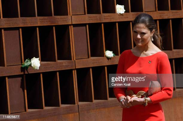 Crown Princess Victoria of Sweden puts roses on a memorial to remember the Berlin wall on May 27 2011 in Berlin Germany