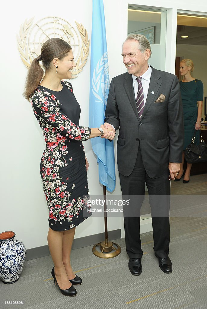 Crown Princess Victoria of Sweden shakes hands with UN Deputy Secretary General Jan Eliasson during her visit to the United Nations at the United Nations on October 4, 2013 in New York City.