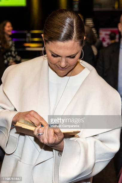 Crown Princess Victoria of Sweden signs a guest book while attending the Folk and Culture 2020 festival at STIGA Sports Arena on February 5 2020 in...