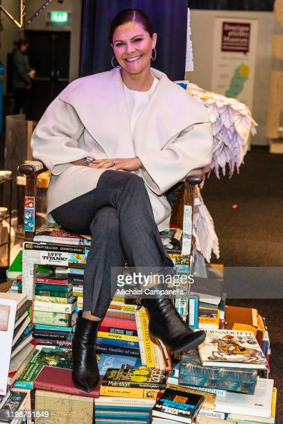 Crown Princess Victoria of Sweden sits on a throne made of books while attending the Folk and Culture 2020 festival at STIGA Sports Arena on February...