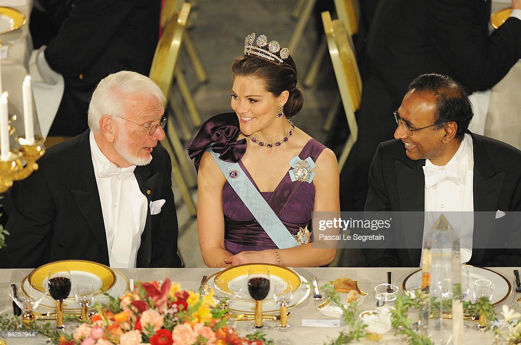 Crown Princess Victoria of Sweden talks to Thomas A. Steitz (L) and Venkatraman Ramakrishnan, winners of the Nobel Prize in Chemistry during the Nobel Foundation Prize Banquet 2009 at the Town Hall on December 10, 2009 in Stockholm, Sweden.
