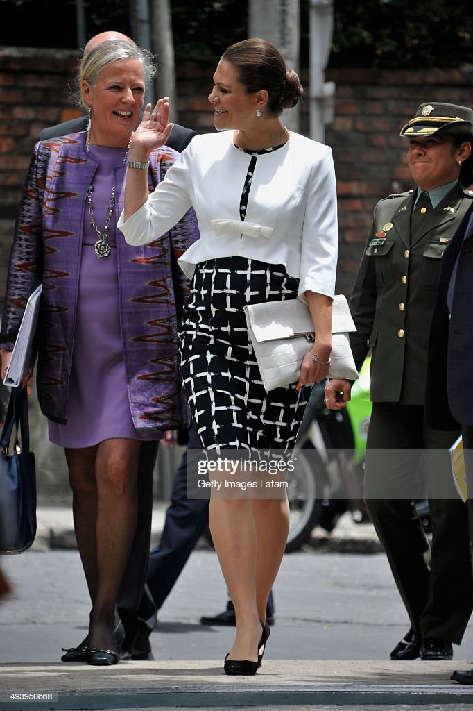 Crown Princess Victoria of Sweden waves after a meeting with leaders of the Swedish Colombian alumni network at the residence of the Swedish Ambassador, Marie Andersson (L) on October 23, 2015 in Bogota, Colombia.