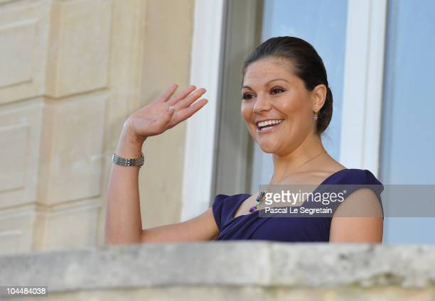 Crown Princess Victoria of Sweden waves as she arrives to attend reception at Sceaux Town hall on September 27 2010 in Paris France