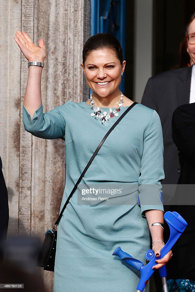 Crown Princess Victoria of Sweden waves to supporters after her visit at the town hall on January 29, 2014 in Dusseldorf, Germany.