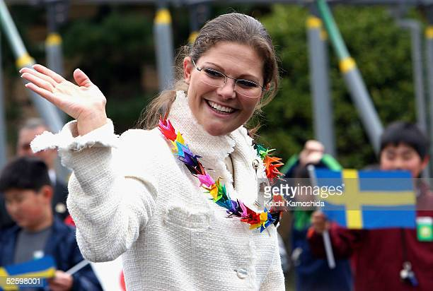Crown Princess Victoria of Sweden waves to the crowd as she attends a welcome ceremony with Japanese students in the schoolyard of Umezono elementary...