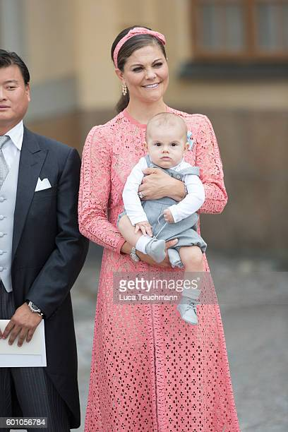 Crown Princess Victoria of Sweden with her son Prince Oscar attend the christening of Prince Alexander of Sweden at Drottningholm Palace Chapel on...