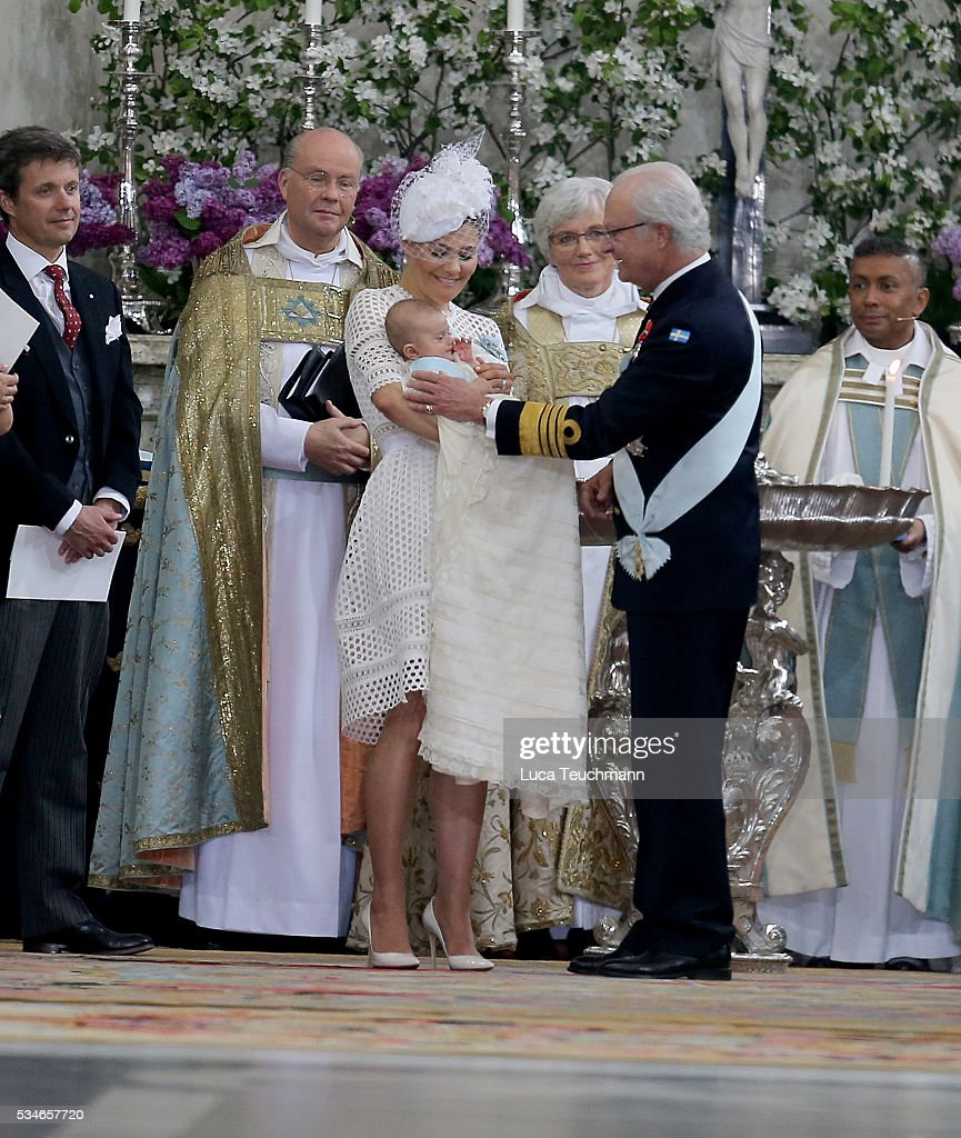 Crown Princess Victoria of Sweden,Prince Oscar of Sweden and King Carl Gustaf of Sweden are seen at The Royal Palace for the Christening of Prince Oscar of Sweden on May 27, 2016 in Stockholm, Sweden.