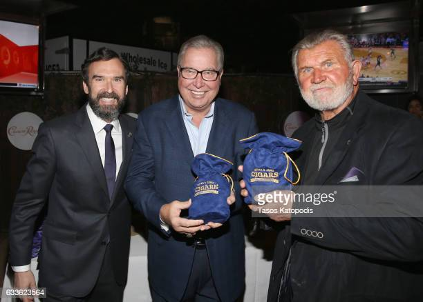 Crown Royal National Brand Ambassador Steven Wilson gifts former NFL quarterback and ESPN NFL analyst Ron Jaworski and former NFL player, coach and...