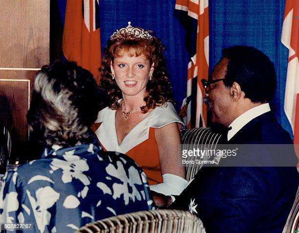 Crowned head Sarah Duchess of York breaks bread with LieutenantGovernor Lincoln Alexander right her husband Andrew and more than 1000 others last...