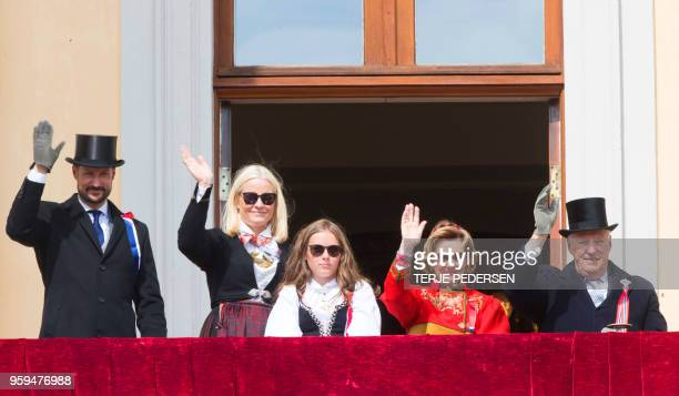 Crownprince Haakon of Norway Crownprincess MetteMarit of Norway Princess Ingrid Alexandra of Norway Queen Sonja and King Harald of Norway wave from...
