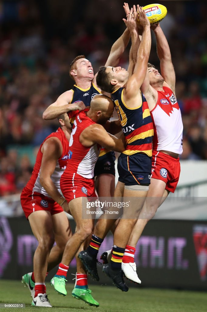 Crows and Swans players contest the ball during the round five AFL match between the Sydney Swans and the Adelaide Crows at Sydney Cricket Ground on April 20, 2018 in Sydney, Australia.