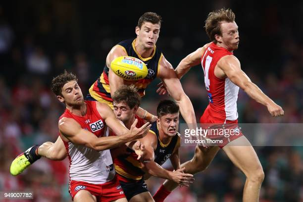 Crows and Swans players contest the ball during the round five AFL match between the Sydney Swans and the Adelaide Crows at Sydney Cricket Ground on...