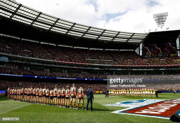 Crows and Tigers players line up for the national anthem during the 2017 Toyota AFL Grand Final match between the Adelaide Crows and the Richmond...