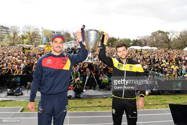 Crows captain Taylor Walker and Tigers captain Trent Cotchin pose with the AFL Premiership trophy during the 2017 AFL Grand Final Parade ahead of the...