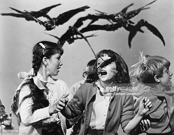 Crows chasing school children in Alfred Hitchcock's The Birds.