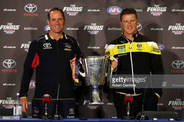 Crows coach Don Pyke and Tigers coach Damien Hardwick pose with the AFL Premiership Cup during the 2017 AFL Grand Final press conference on September...