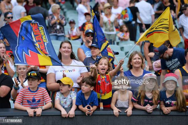 Crows fans celebrate after the AFLW Preliminary Final match between the Adelaide Crows and thew Geelong Cats at Adelaide Oval on March 24 2019 in...