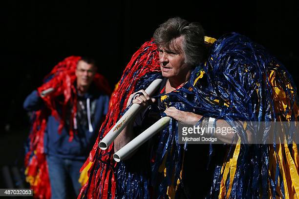 Crows fans walk in with streamers during the round six AFL match between the Western Bulldogs and the Adelaide Crows at Etihad Stadium on April 27...