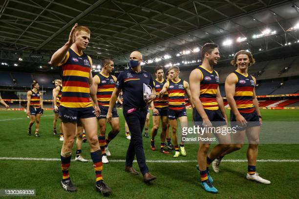Crows Head coach Matthew Nicks speaks with Reilly O'Brien of the Crows as they leave the field after the round 20 AFL match between Adelaide Crows...
