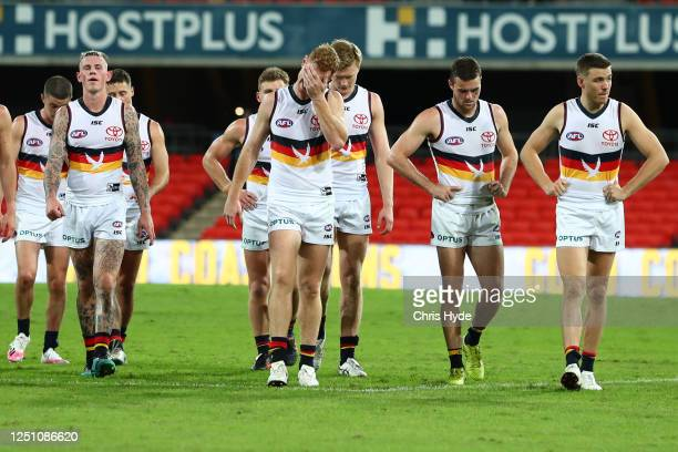 Crows leave the field after losing the round 3 AFL match between the Gold Coast Suns and the Adelaide Crows at Metricon Stadium on June 21, 2020 in...