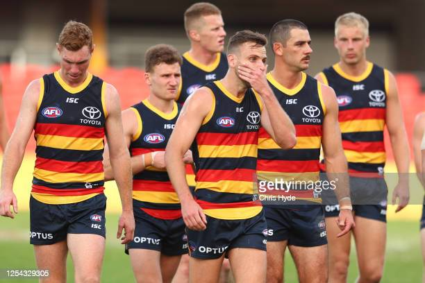 Crows leave the field after losing the round 5 AFL match between the Adelaide Crows and the Fremantle Dockers at Metricon Stadium on July 05, 2020 in...