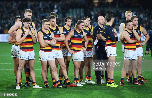 Crows players and Matthew Nicks coach of the Crows watch The Variety Showdown Shield presentation during the round eight AFL match between the Port...