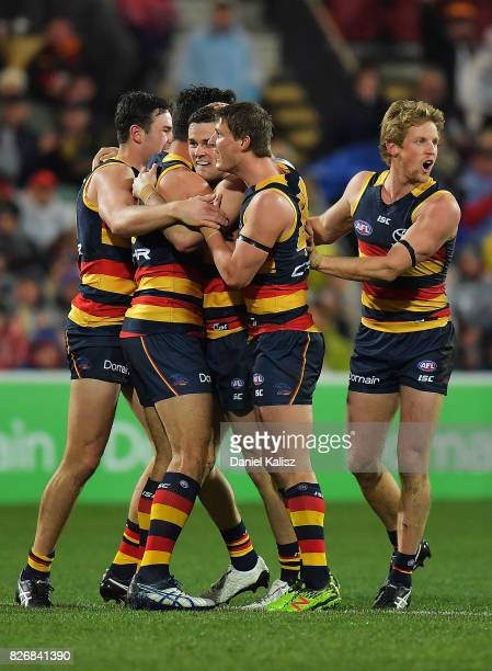 Crows players celebrate after scoring a goal during the round 20 AFL match between the Adelaide Crows and the Port Adelaide Power at Adelaide Oval on...