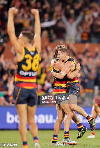Crows players celebrate after the final siren during the round 10 AFL match between the Adelaide Crows and the Melbourne Demons at Adelaide Oval on...