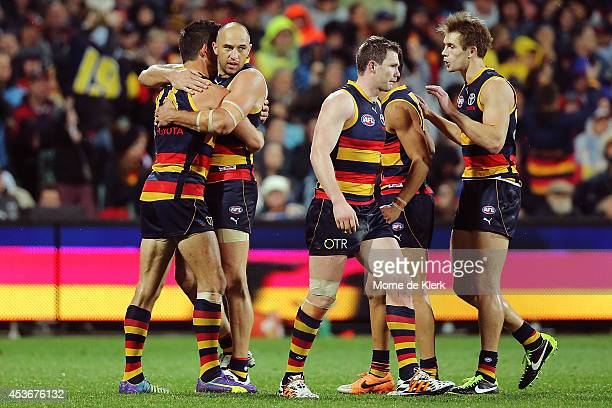 Crows players celebrate with James Podsiadly after he kicked a goal during the round 21 AFL match between the Adelaide Crows and the Richmond Tigers...