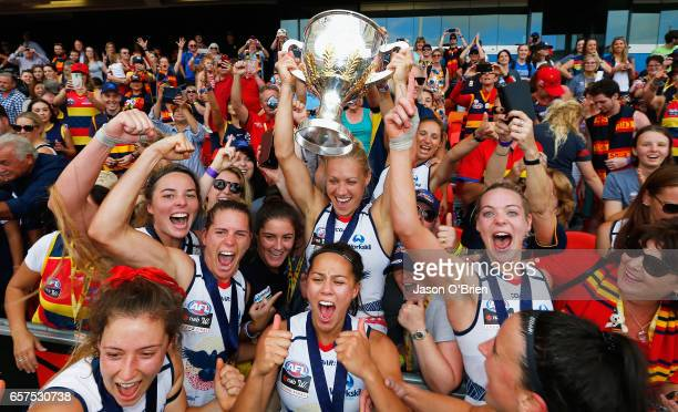 Crows players celebrate with their fans during the AFL Women's Grand Final between the Brisbane Lions and the Adelaide Crows on March 25, 2017 in...