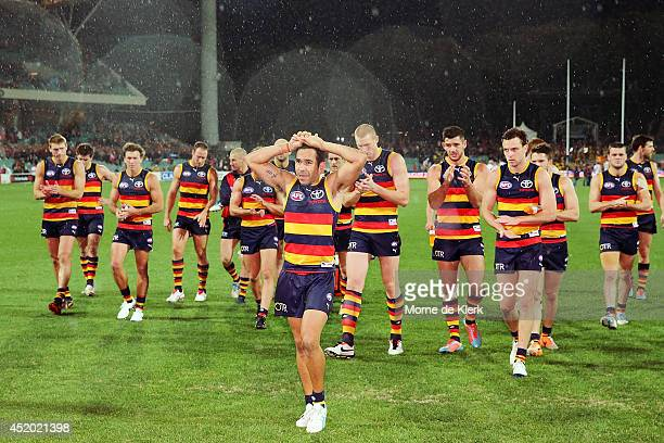 Crows players leave the field lead by Eddie Betts during the round 17 AFL match between the Adelaide Crows and the Hawthorn Hawks at Adelaide Oval on...