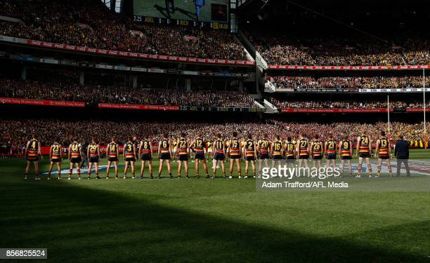 Crows players line up for the national anthem during the 2017 Toyota AFL Grand Final match between the Adelaide Crows and the Richmond Tigers at the...