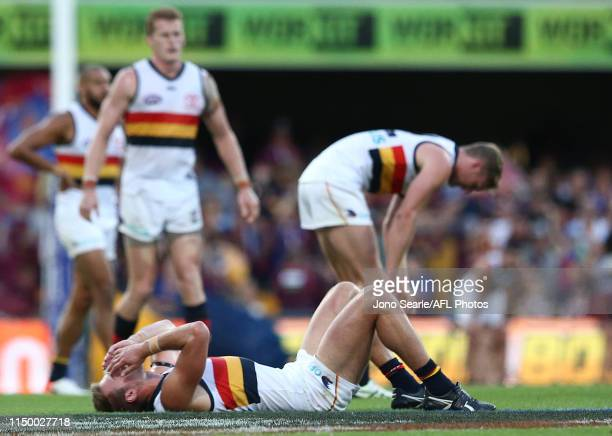 Crows players react to the loss during the round nine AFL match between the Brisbane Lions and the Adelaide Crows at The Gabba on May 18 2019 in...