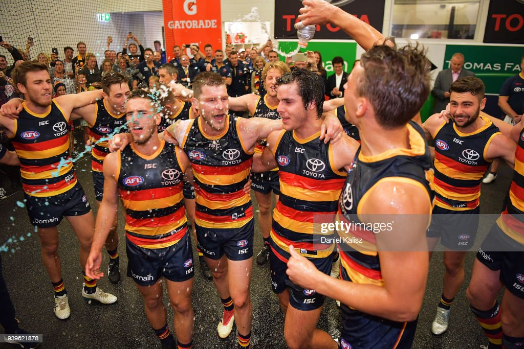 Crows players sing the club song after defeating the Richmond Tigers during the round two AFL match between the Adelaide Crows and the Richmond Tigers at Adelaide Oval on March 29, 2018 in Adelaide, Australia.