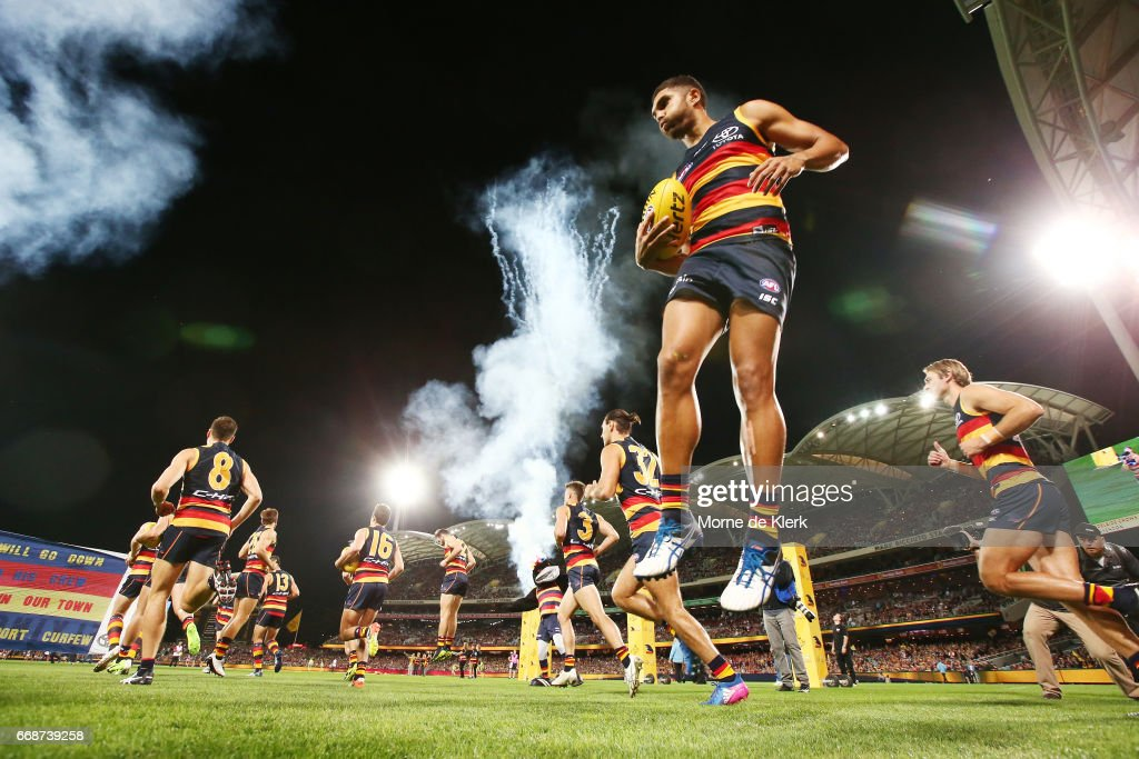 Crows players take the field before the start of the round four AFL match between the Adelaide Crows and the Essendon Bombers at Adelaide Oval on April 15, 2017 in Adelaide, Australia.