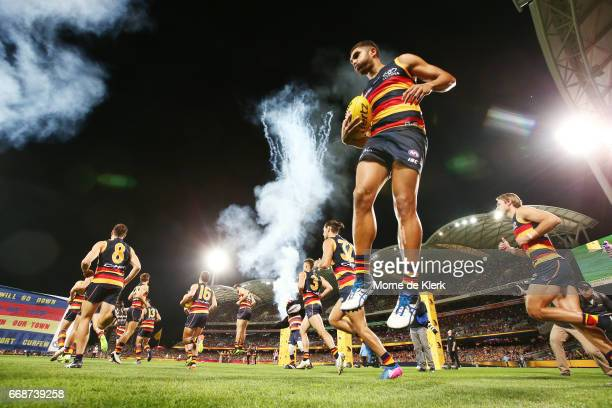 Crows players take the field before the start of the round four AFL match between the Adelaide Crows and the Essendon Bombers at Adelaide Oval on...
