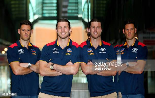 Crows recruits Bryce Gibbs and Sam Gibson are reflected in a window as they pose following the AFL Draft Period at Etihad Stadium on October 19 2017...