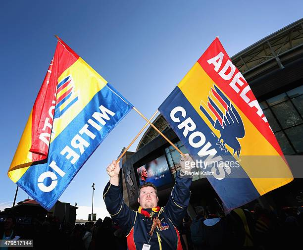 Crows supporter is seen holding two flags at Adelaide Oval on July 5 2015 in Adelaide Australia Adelaide Crows AFL coach Phil Walsh was found dead in...