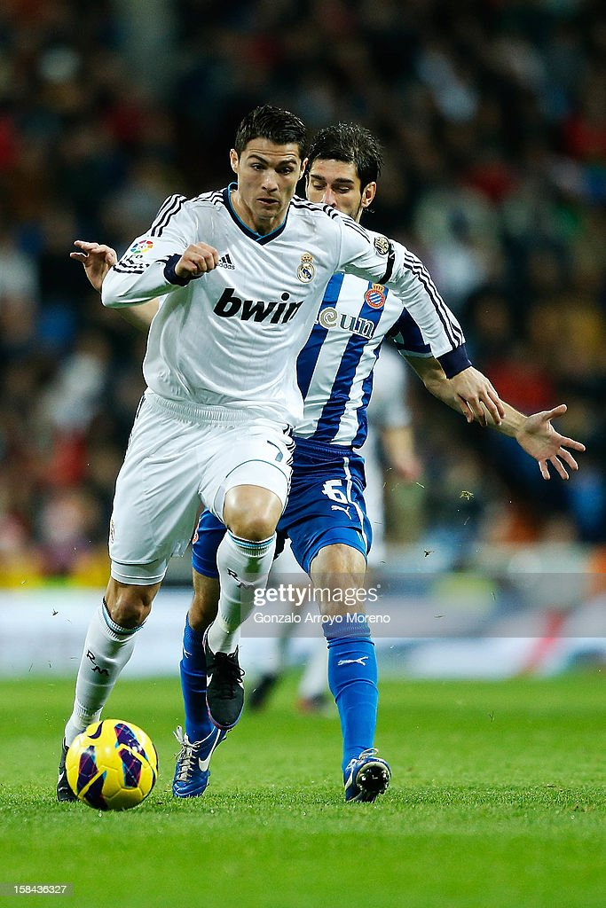 Crsitiano Ronaldo of Real Madrid CF competes for the ball with Juan Daniel Forlin of RCD Espanyol during the La Liga match between Real Madrid CF and RCD Espanyol at Estadio Santiago Bernabeu on December 16, 2012 in Madrid, Spain.