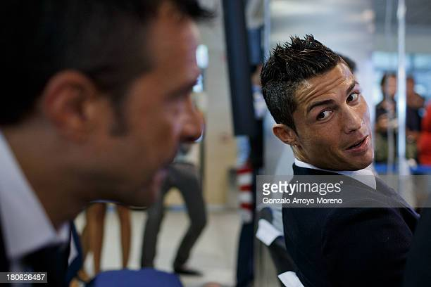 Crsitiano Ronaldo speaks with his agent Jorge Mendes after his signing contract renewal For Real Madrid at Estadio Santiago Bernabeu on September 15,...