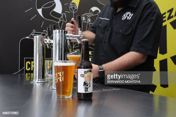 Cru Cru Brewery CEO Luis Enrique de la Reguera serves an Amigous Craft Beer which bottle shows an image of US President Donald Trump wearing a...