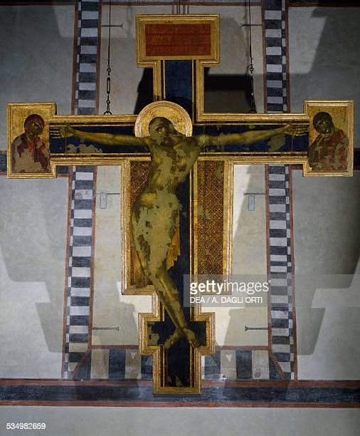 Crucifix 12871288 by Cenni di Pepo known as Cimabue tempera on panel 448x390 cm after the damage of the 1966 Flood Basilica of Santa Croce Florence...