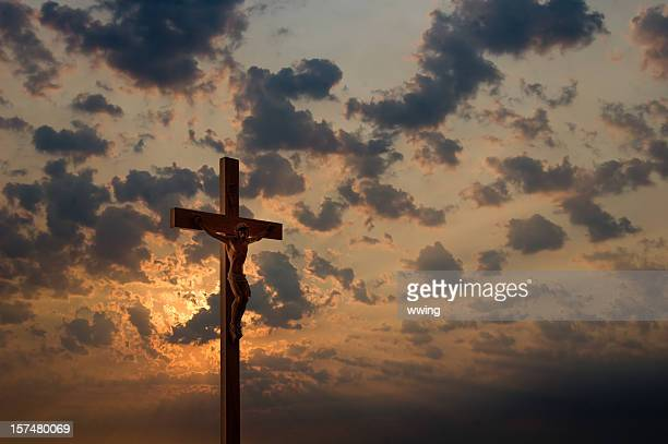 crucifix and dramatic sky - images of jesus on the cross at calvary stock pictures, royalty-free photos & images