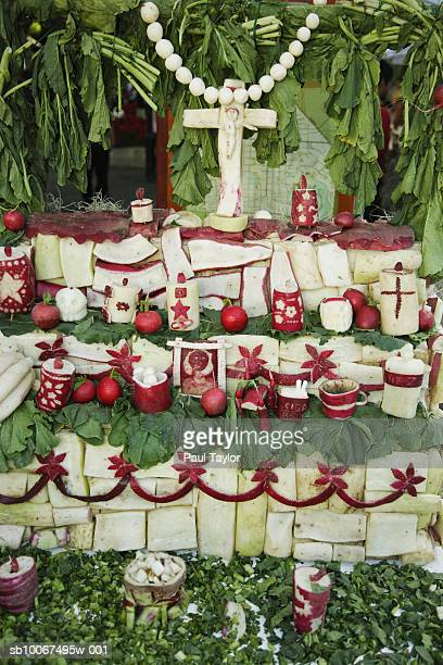 Crucifix and religious carvings made from large radish
